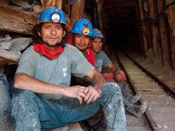 Minera Aurifera Cuatro de Enero - Miners at the entrance of a gold mine at Cuatro Horas in the Chaparra district, province of Caraveli, department of Arequipa, Peru